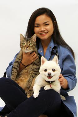Photo of student veterinarian Angie with her cat and dog