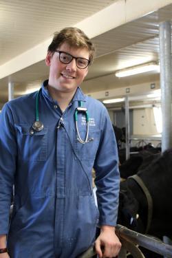 Student veterinarian Eastman in dairy barn